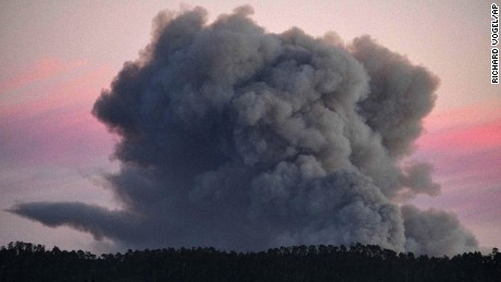 A large plume of smoke from a wildfire rises near Highway 1, burning five miles south of Carmel, California, on Friday, July 22.