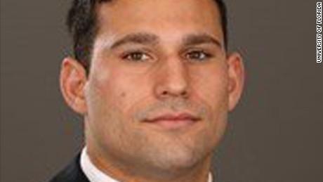 Football player, co-worker intervene in alleged rape behind bar