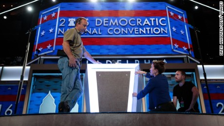 PHILADELPHIA, PA - JULY 24: Workers prepare the podium ahead of the Democratic National Convention at the Wells Fargo Center, July 24, 2016 in Philadelphia, Pennsylvania. The Democratic National Convention will formally kick off on Monday. (Photo by Drew Angerer/Getty Images)