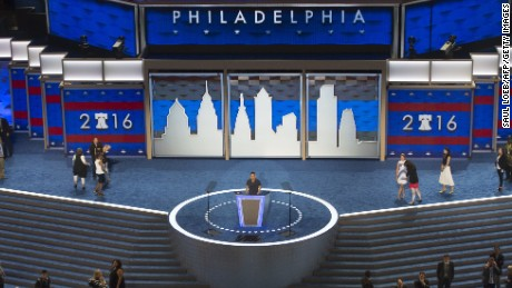 Workers prepare the stage at the Democratic National Convention at the Wells Fargo Center in Philadelphia, Pennsylvania, July 24, 2016.   US Democrats converge on the City of Brotherly Love to elevate Hillary Clinton this coming week as the party's nominee who will battle Republican Donald Trump in 2016's presidential election. / AFP / SAUL LOEB        (Photo credit should read SAUL LOEB/AFP/Getty Images)