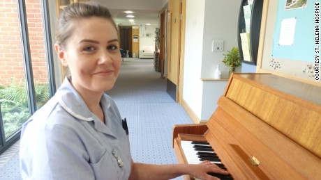 St. Helena Hospice nurse's assistant Emma Young with the piano from the video.