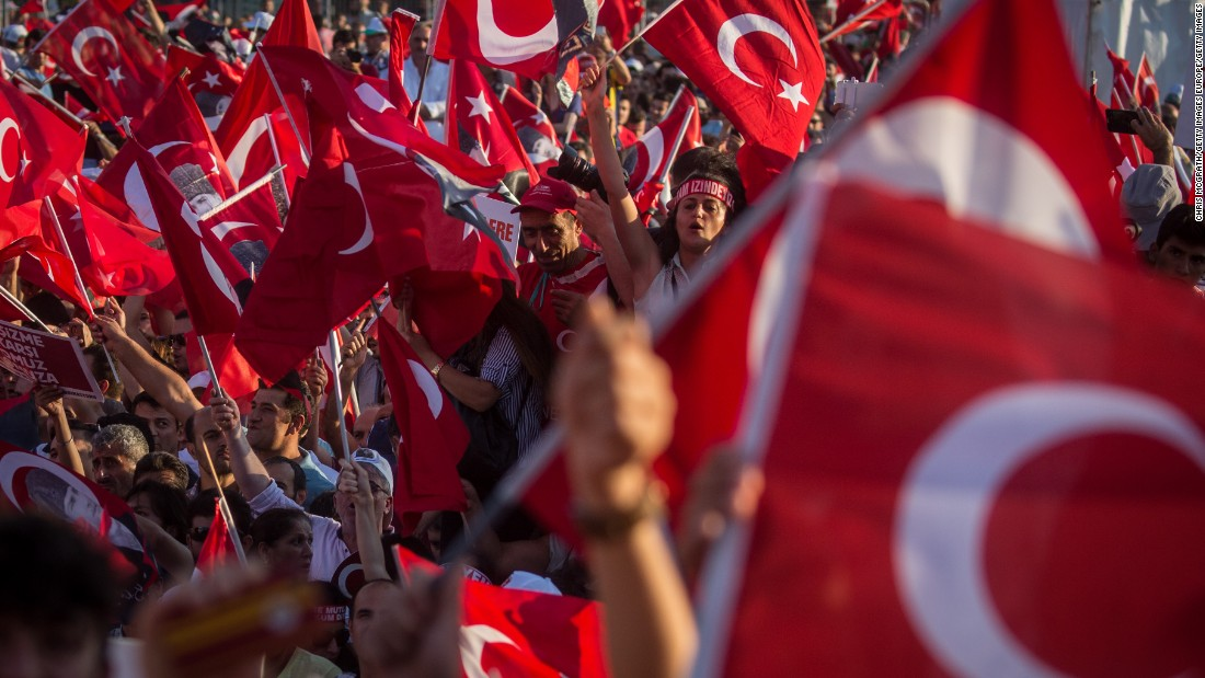 """The mood at the demonstration, dubbed the """"Republic and Democracy Rally,"""" was celebratory and patriotic and a rare show of unity between government and opposition supporters."""