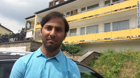 "Mubariz Mahmoof from Pakistan (pictured), a neighbor of the the Ansbach bomber, told CNN the attacker was general ""friendly and happy."""