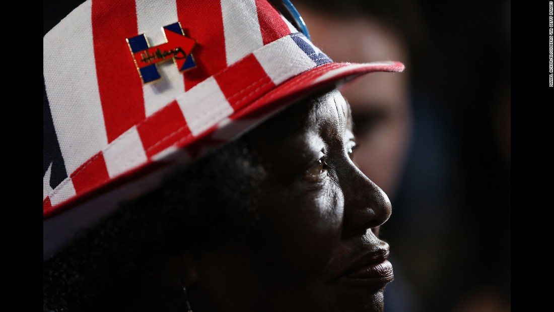 A delegate wears a pin showing her support of Clinton.