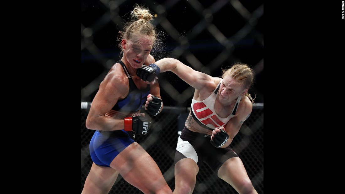 Valentina Shevchenko punches Holly Holm during a UFC bout in Chicago on Saturday, July 23. Shevchenko won by unanimous decision.