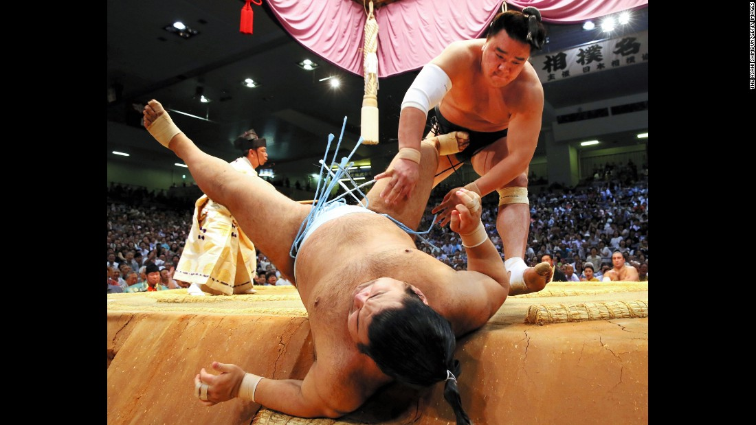 Harumafuji throws Takayasu during the Grand Sumo Tournament in Nagoya, Japan, on Tuesday, July 19. Harumafuji would go on to win the tournament.