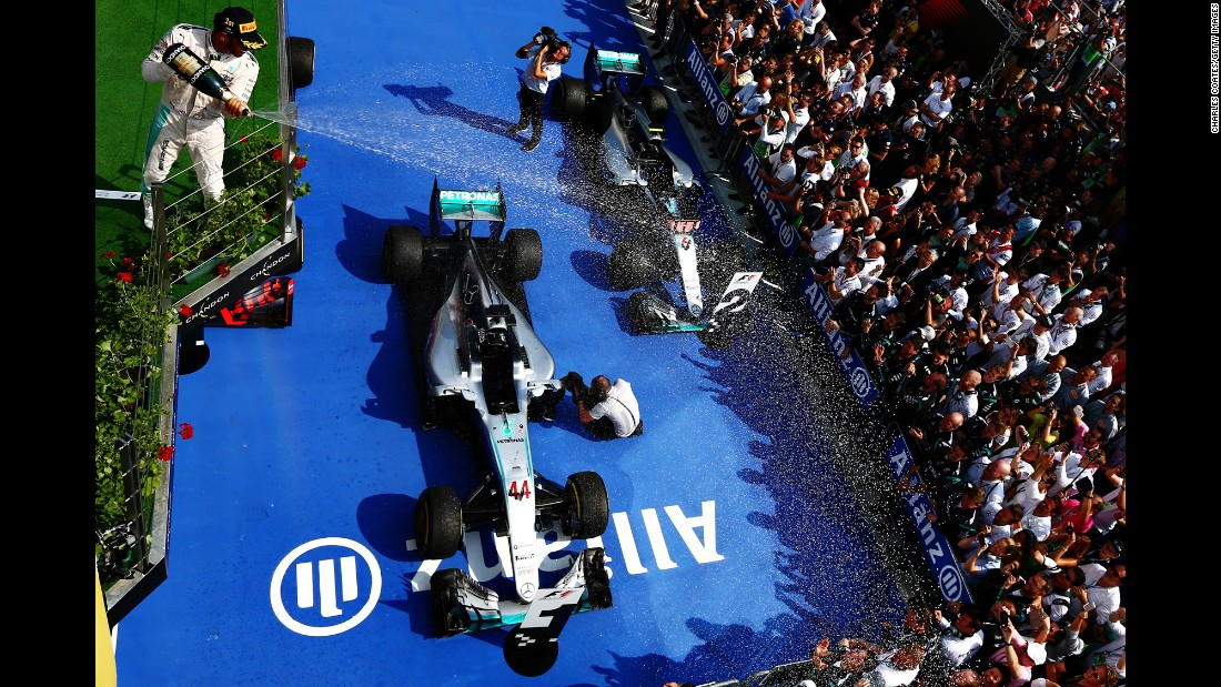"Formula One driver Lewis Hamilton celebrates on the podium after <a href=""http://www.cnn.com/2016/07/24/motorsport/hungarian-grand-prix-lewis-hamilton/index.html"" target=""_blank"">winning the Hungary Grand Prix</a> on Sunday, July 24. It was the third straight victory for Hamilton, the 2015 champion, and he is now in first place in the overall standings."