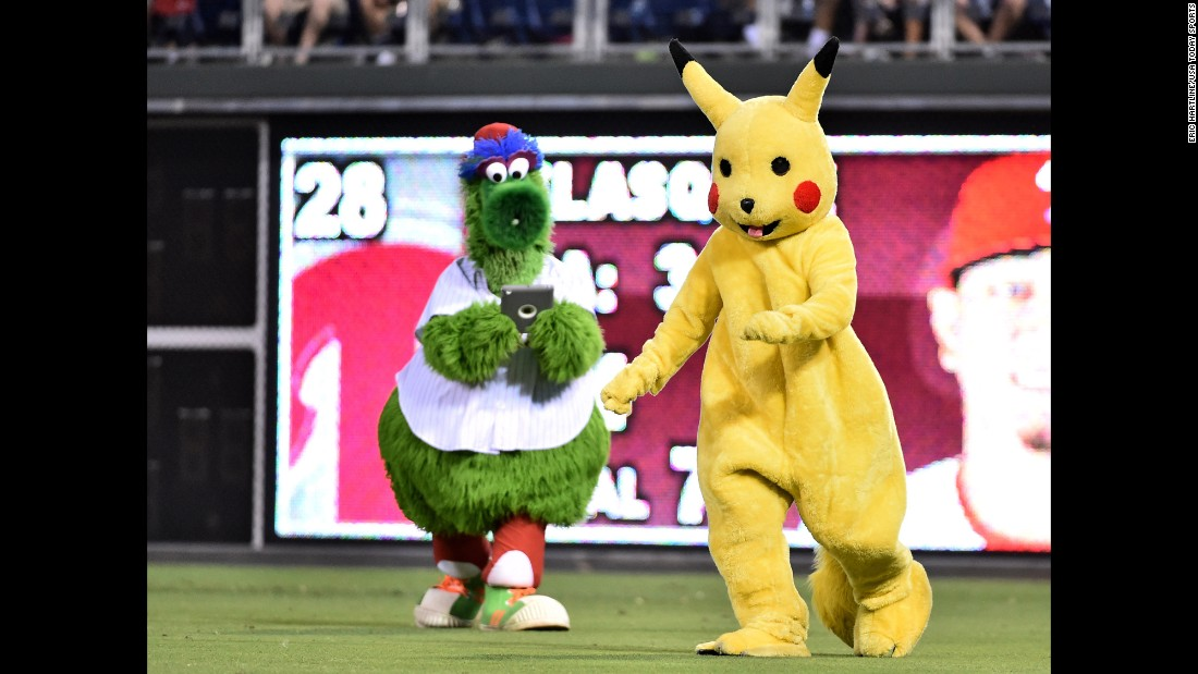 "Even the Phillie Phanatic has <a href=""http://www.cnn.com/2016/07/11/health/pokemon-go-guide-trnd/index.html"" target=""_blank"">Pokemon fever.</a> The iconic mascot, left, tries to capture Pikachu during a Philadelphia Phillies game on Tuesday, July 19."