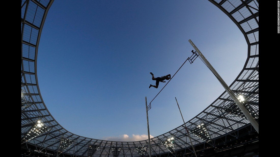 French pole vaulter Renaud Lavillenie -- the world-record holder in the event -- clears the bar during the Diamond League meet in London on Friday, July 22. He won with a jump of 5.9 meters (19.36 feet).