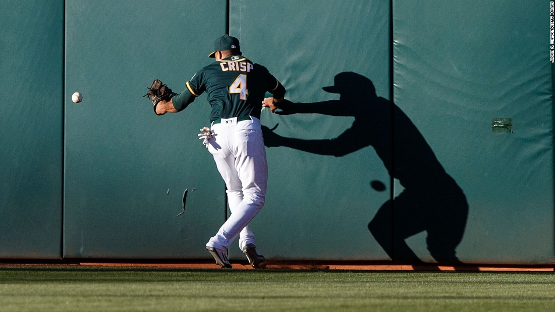 Oakland outfielder Coco Crisp is unable to catch a fly ball during a home game against Tampa Bay on Saturday, July 23.