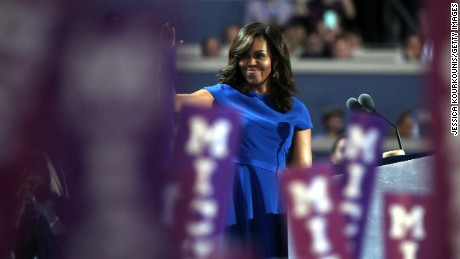 First lady Michelle Obama waves to the crowd before delivering remarks on the first day of the Democratic National Convention at the Wells Fargo Center, July 25, 2016 in Philadelphia, Pennsylvania.