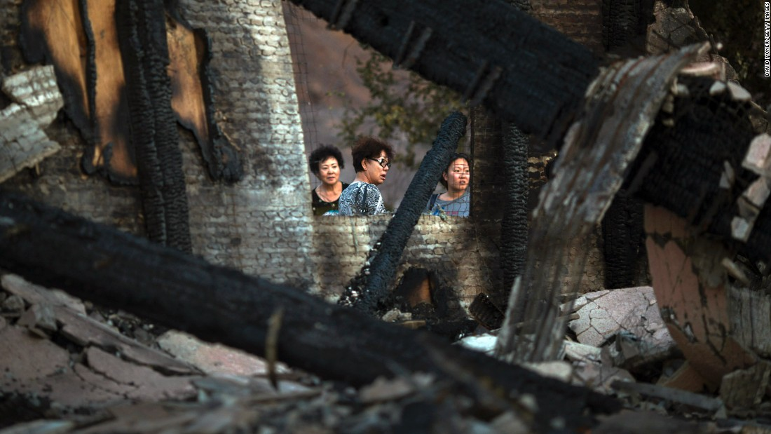 Residents return to a home that was destroyed by fire in Santa Clarita.