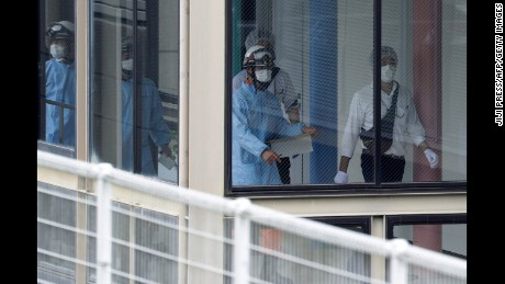 Rescue workers are seen at the Tsukui Yamayuri-en care center