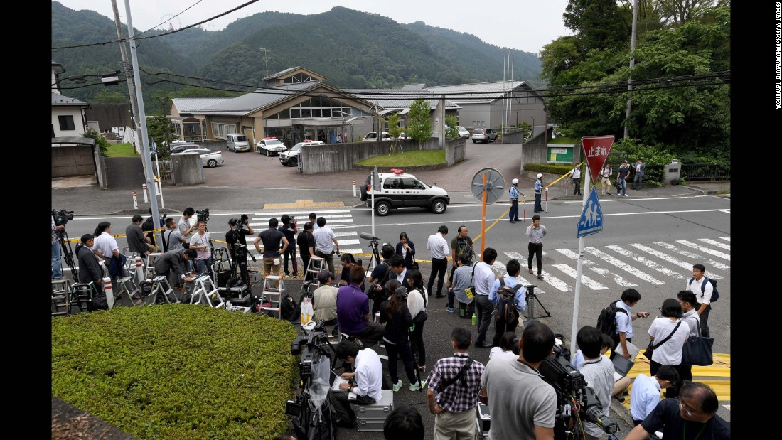 Journalists congregate outside the Tsukui Yamayuri-en center, a care facility for the mentally disabled 25 miles west of Tokyo, where a man with a knife killed 19 and injured 26 people during a rampage early Tuesday, July 26.