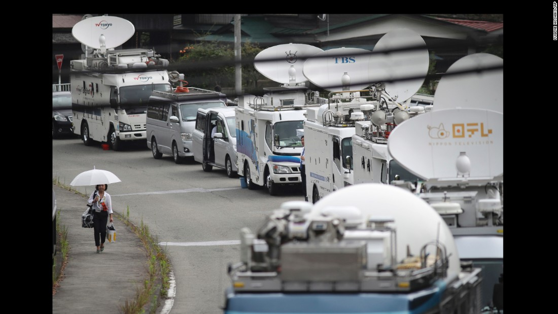 A  convoy of media broadcast vans converges on the scene of the crime, which sent shock waves through Japan, where gun ownership is highly restricted and mass killings are rare.