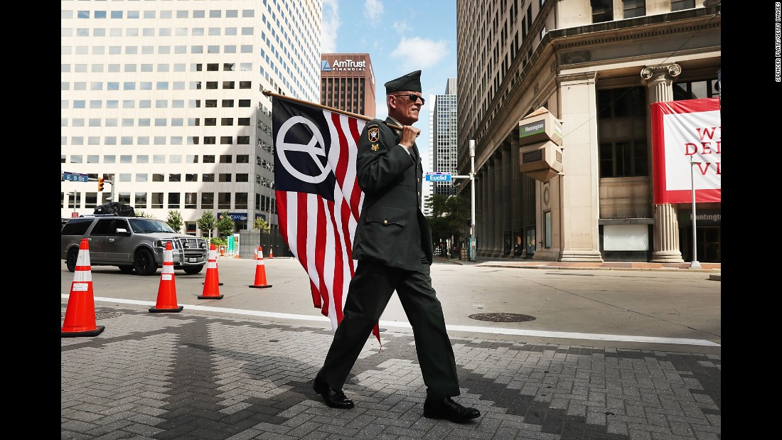 "Lou Pumphrey, who is with the nonprofit Veterans for Peace, walks through downtown Cleveland on Sunday, July 17, ahead of the <a href=""http://www.cnn.com/2016/07/20/politics/gallery/outside-rnc-van-agtmael/index.html"" target=""_blank"">Republican National Convention.</a>"
