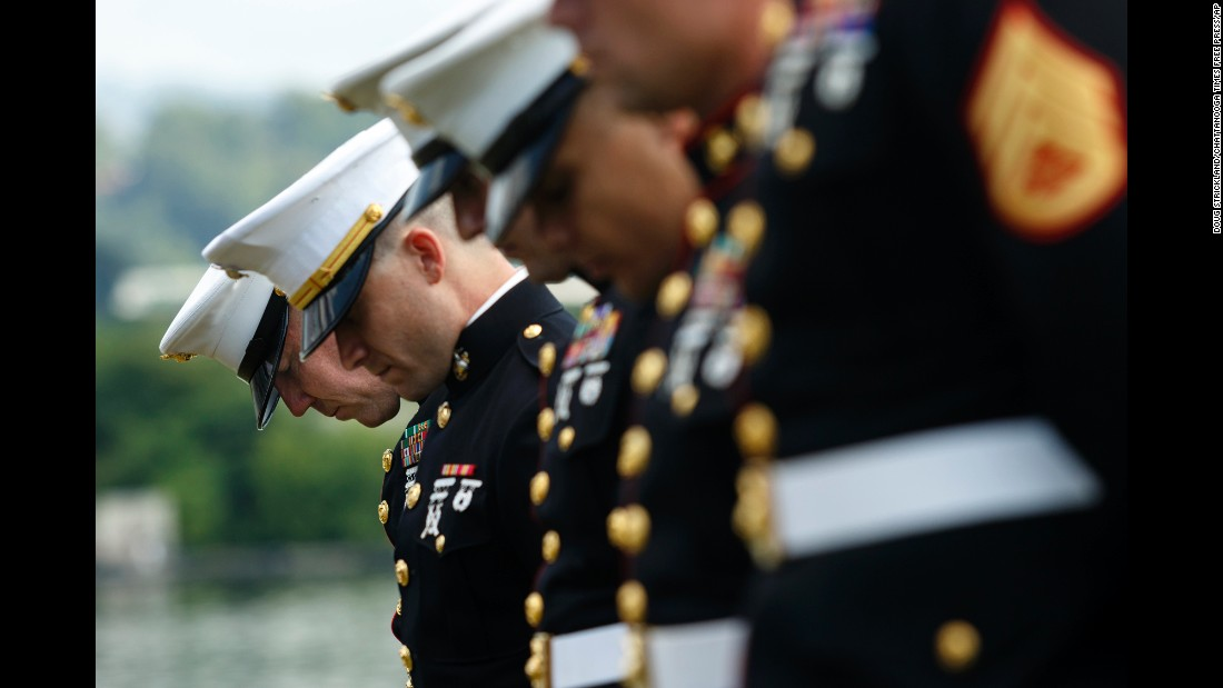 "U.S. Marines bow their heads during a memorial service in Chattanooga, Tennessee, on Saturday, July 16. The service marked one year since <a href=""http://www.cnn.com/2015/07/20/us/tennessee-naval-reserve-shooting/"" target=""_blank"">four Marines and a sailor were killed by a lone gunman</a> who shot up a military recruiting center and a local Navy operations support center."