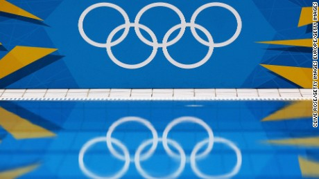 LONDON, ENGLAND - JULY 26:  A detail of the Olympic Rings reflects in the pool water during a training session ahead of the London Olympic Games at the Aquatics Centre in Olympic Park on July 26, 2012 in London, England.  (Photo by Clive Rose/Getty Images)