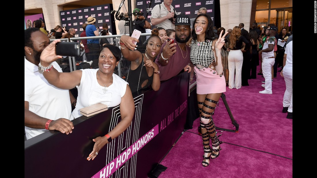 Model Winnie Harlow takes a selfie with a fan in New York on Monday, July 11. Harlow was attending VH1 Hip Hop Honors: All Hail the Queens.
