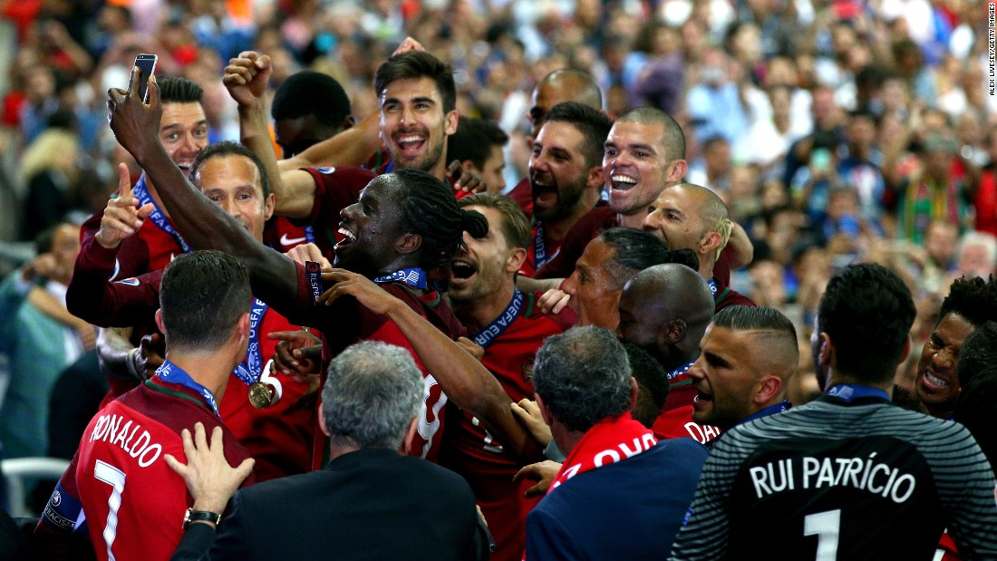 Eder, the soccer player who scored the game-winning goal for Portugal in the Euro 2016 final, takes a selfie with his teammates during the award ceremony on Sunday, July 10.