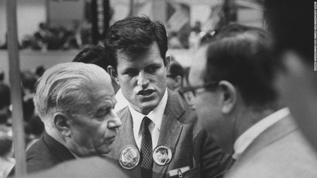 The youngest Kennedy brother, Ted, speaks to delegates on the convention floor. The 28-year-old, who later became a senator himself, helped run his brother's presidential campaign in western states.
