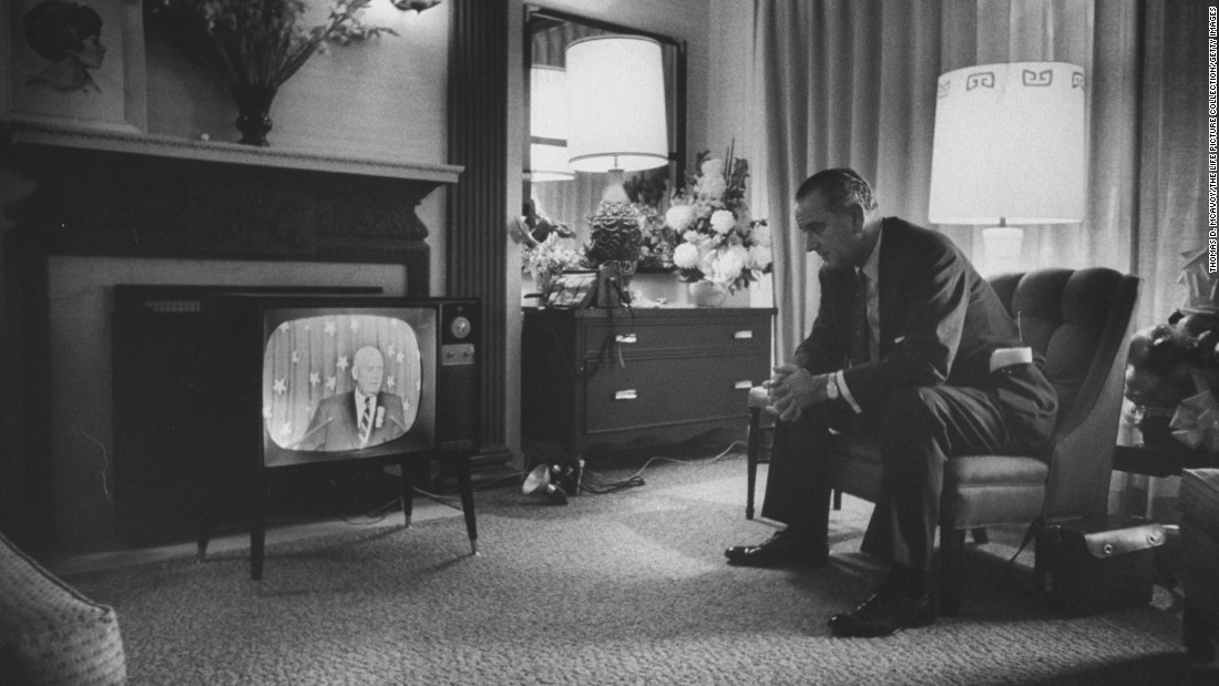Johnson watches television during the convention. He received 409 votes on the only convention ballot, far behind Kennedy's 806. Historians believe Kennedy wanted Johnson on the ticket to help him carry Texas and some Southern states.