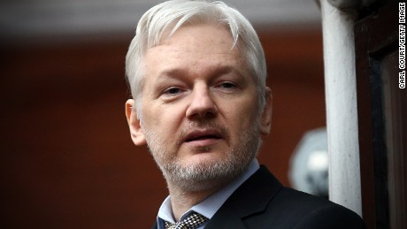 Wikileaks founder Julian Assange speaks from the balcony of the Ecuadorian embassy where  he continues to seek asylum following an extradition request from Sweden in 2012, on February 5, 2016 in London, England