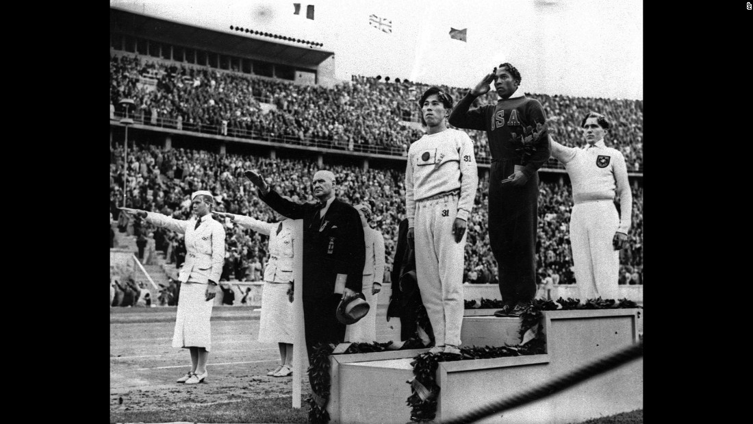 "U.S. track star Jesse Owens stands atop the medal stand after he won the long jump at the 1936 Olympics in Berlin. It was one of four gold medals that Owens won at the Berlin Games, which took place during the rule of Adolf Hitler and Nazi Germany. Hitler wanted the Games to showcase what he believed to be the racial superiority of white Aryan athletes, <a href=""http://edition.cnn.com/2008/SPORT/05/01/jesseowens/index.html"" target=""_blank"">but Owens spoiled that idea</a> and became a cultural icon."