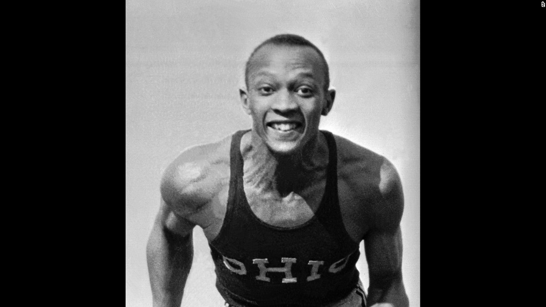 "Owens poses in his Ohio State track jersey in April 1935. His full name was James Cleveland (J.C.) Owens. He got the nickname Jesse from his first schoolteacher in Cleveland. She misunderstood Owens when he said J.C., and <a href=""http://www.jesseowens.com/about/"" target=""_blank"">she put his name down as Jesse.</a>"