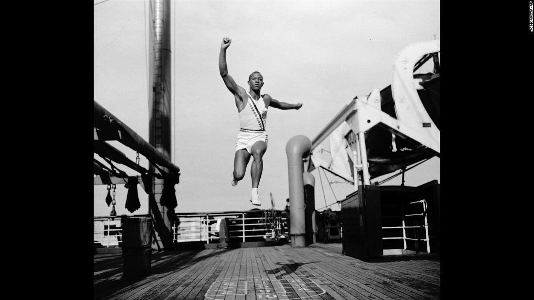 Owens practices the long jump on a boat as he travels to Berlin for the Olympics in 1936.