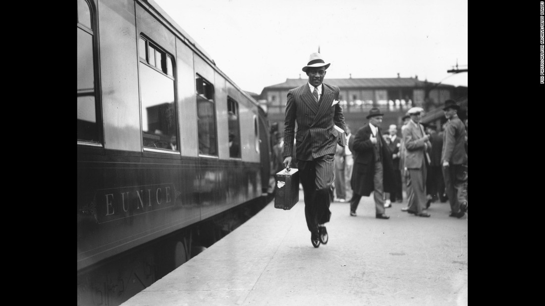 Owens dashes for a train at London's Waterloo station before heading back to the United States.