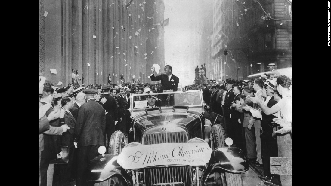 Owens takes part in a ticker-tape parade in New York in September 1936.