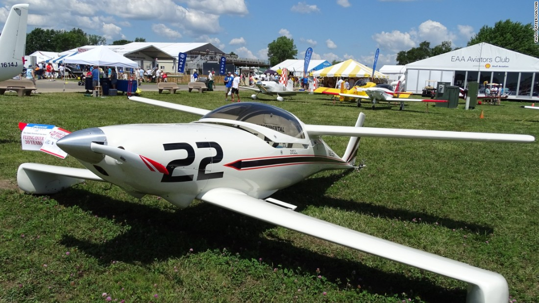 Sam Hoskins bought a kit to build the Quickie Q-200 in 1981. The plane has two sets of wings. The front wings are called canards and include the plane's landing gear. Note: there's no horizontal stabilizer on the tail. This is just one of many unusual planes at the 2016 AirVenture air show in Oshkosh, Wisconsin.
