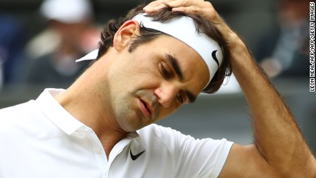 TOPSHOT - Switzerland's Roger Federer reacts after losing a point to Canada's Milos Raonic during their men's semi-final match on the twelfth day of the 2016 Wimbledon Championships at The All England Lawn Tennis Club in Wimbledon, southwest London, on July 8, 2016. / AFP / LEON NEAL / RESTRICTED TO EDITORIAL USE        (Photo credit should read LEON NEAL/AFP/Getty Images)