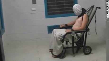 "The Australian Broadcasting Corp.'s ""Four Corners"" program reported that this image shows Dylan Voller, then 17, in a white hood, shackled at the neck with his arms strapped to a chair at a detention center in Alice Springs, Australia, in 2015."