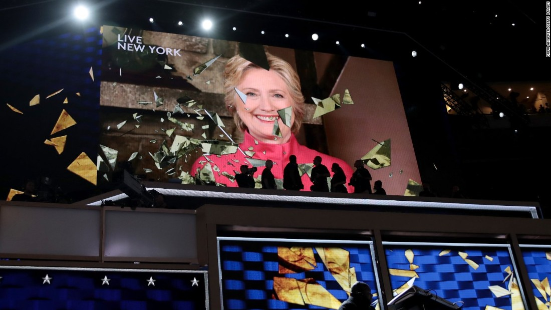 "Clinton appears live on a video screen Tuesday night. Just a few hours earlier, she officially became the party's presidential nominee. She is the first woman to lead a major party's presidential ticket. ""I can't believe we just put the biggest crack in that glass ceiling yet,"" she told the crowd."