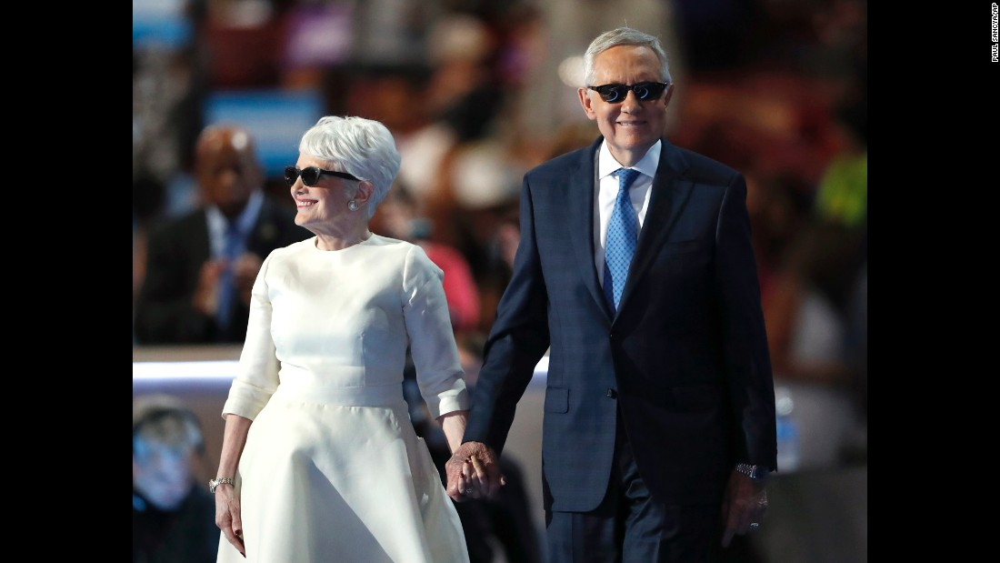 Senate Minority Leader Harry Reid is escorted to the podium by his wife, Landra, on Wednesday.