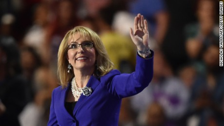 Former Congresswoman Gabby Giffords waves during the third evening session of the Democratic National Convention at the Wells Fargo Center in Philadelphia, Pennsylvania, July 27, 2016.