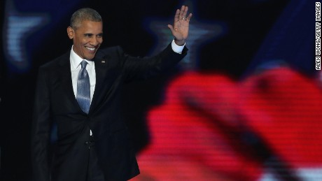 US President Barack Obama acknowledges the crowd as he arrives on stage to deliver remarks on the third day of the Democratic National Convention at the Wells Fargo Center, July 27, 2016 in Philadelphia, Pennsylvania. Democratic presidential candidate Hillary Clinton received the number of votes needed to secure the party's nomination. An estimated 50,000 people are expected in Philadelphia, including hundreds of protesters and members of the media. The four-day Democratic National Convention kicked off July 25.