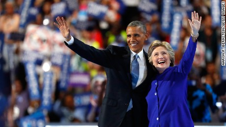 US President Barack Obama and Democratic presidential candidate Hillary Clinton wave to the crowd on the third day of the Democratic National Convention at the Wells Fargo Center, July 27, 2016 in Philadelphia, Pennsylvania. Democratic presidential candidate Hillary Clinton received the number of votes needed to secure the party's nomination. An estimated 50,000 people are expected in Philadelphia, including hundreds of protesters and members of the media. The four-day Democratic National Convention kicked off July 25.
