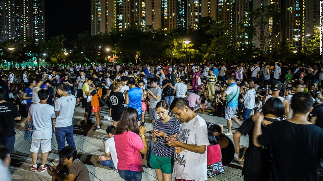 "Since the game's release, hundreds have flocked to Hong Kong's already busy streets and public places, leading some to complain of smartphone ""zombies."""