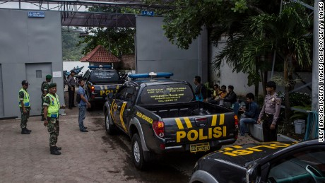 Police patrol cars arrive to an Indonesia prison.