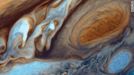 Jupiter's giant red storm makes its atmosphere hotter than molten lava