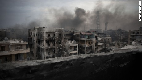 Smoke rises from an Aleppo neighborhood in this file picture.