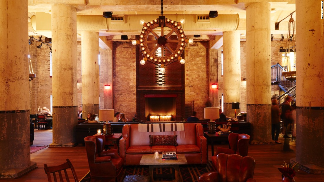 Located in an 1894 brew house, Hotel Emma in San Antonio folds elements of the building's past into its decor. A light fixture at hotel bar Sternewirth incorporates components once used in the brewery's bottling room.