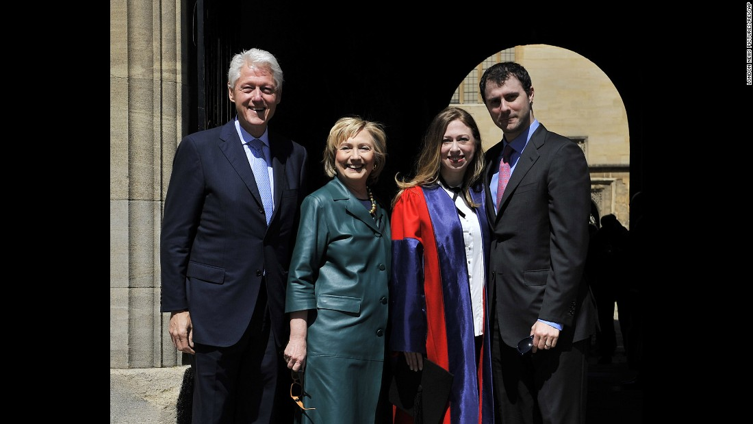 The Clintons and Marc Mezvinsky pose at Radcliffe Square in Oxford, England, where Chelsea graduated with a doctorate degree in international relations from Oxford University in May 2014.