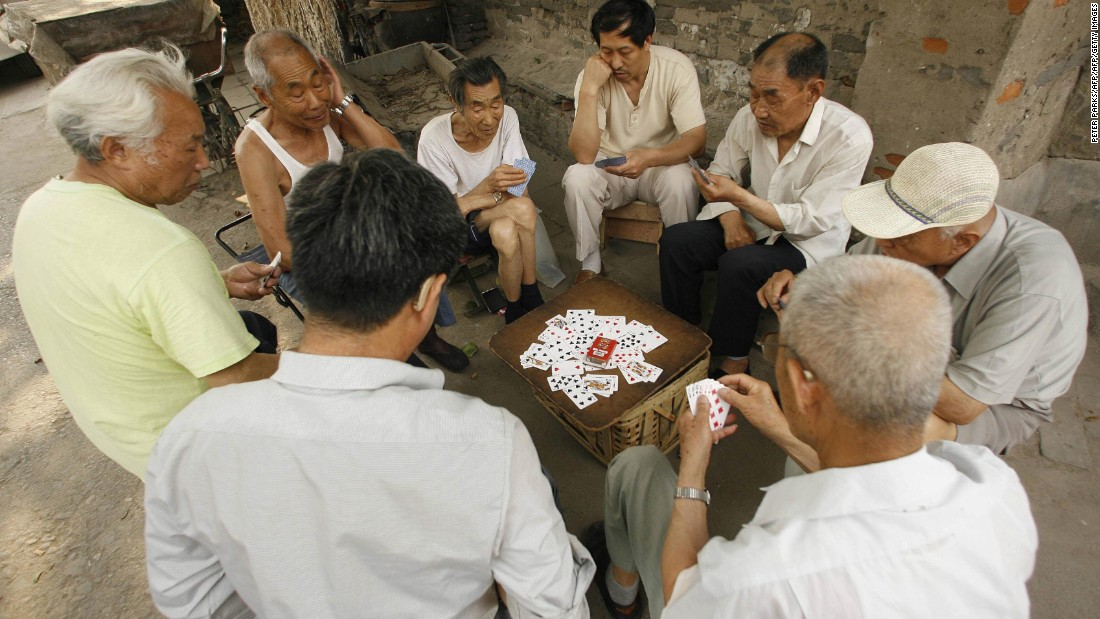 The Hutong neighborhoods have historically supported a communal way of life, with neighbors playing traditional games together.