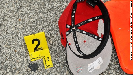FERGUSON, MO - AUGUST 9:  In this handout photo provided by the St. Louis County Prosecutor's Office, Michael Brown's hat is documented at the scene of the shooting on August 9, 2014 in Ferguson, Missouri. Police officer Darren Wilson shot 18-year-old Michael Brown on August 9th, 2014. A St. Louis County 12 member grand jury who reviewed evidence related to the shooting decided not to indict Wilson on charges, sparking large ongoing protests. (Photo by St. Louis County Prosecutor's Office via Getty Images)