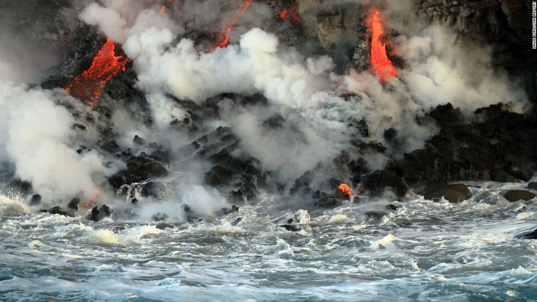 The lava flow is about 66 feet wide at the point where it tumbles off a cliff into the water.