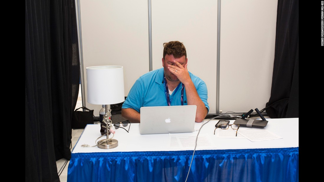 A man works in one of the media tents.